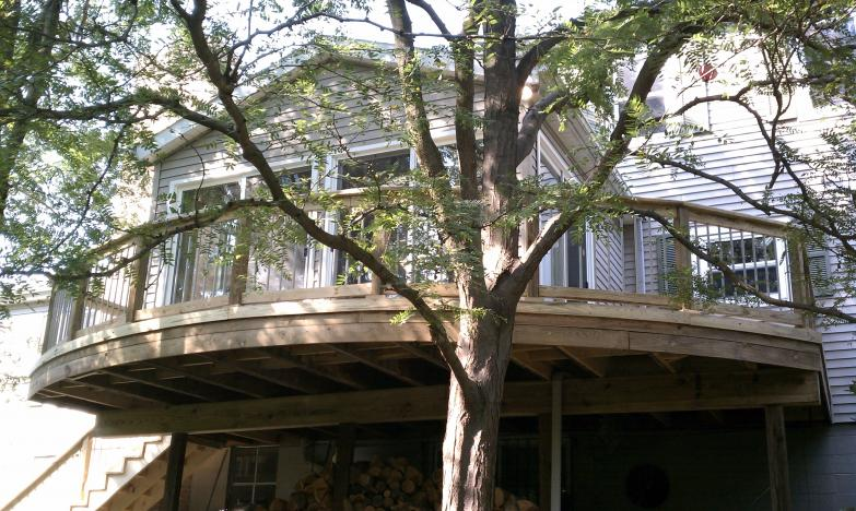 curved treated deck with aluminm balusters